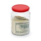 Geld in einem Glasglas wird getrennt Stockfoto