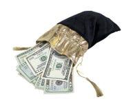 Geld in einem Samtdrawstring-Beutel Stockfoto