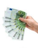 Geld in einer Hand Lizenzfreies Stockbild