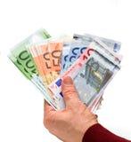 Geld in einer Hand Stockfoto