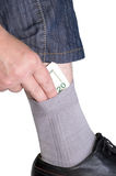 Geld in einer Socke Lizenzfreies Stockfoto
