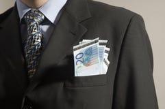 Geld in einer Tasche stockfotos