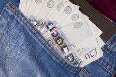 Geld in einer Tasche Lizenzfreies Stockfoto