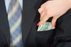 Geld in einer Tasche Stockbild