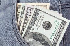 Geld in einer Tasche stockfoto