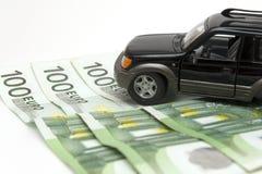 Geld en auto royalty-vrije stock afbeelding
