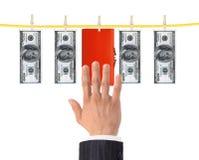 Geld en beurs die en de het droog na was witwassen hangen Royalty-vrije Stock Foto
