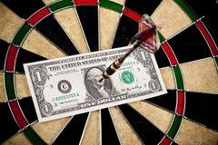 Geld en bullseye Stock Foto's