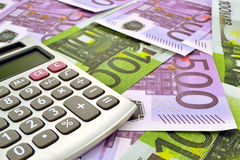 Geld en calculator Stock Afbeelding