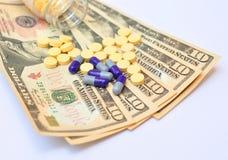 Geld en geneeskunde Stock Fotografie