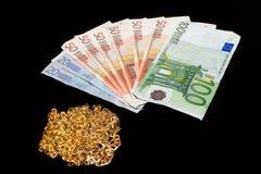 Geld en goud Stock Afbeelding