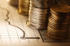 Geld en grafiek Stock Fotografie