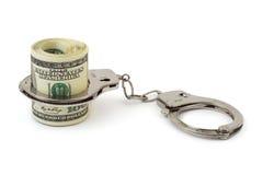 Geld en handboeien Stock Foto