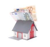 Geld en huis stock foto