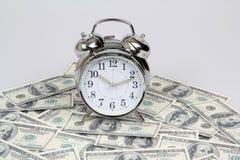 Geld en klok Stock Afbeelding