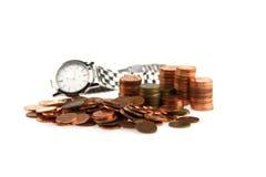 Geld en klok Stock Fotografie