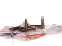 Geld en kogels royalty-vrije stock foto