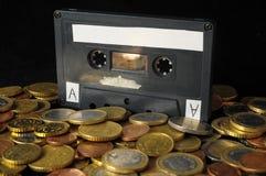 Geld en Muziekconcept Stock Foto's