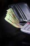 Geld en portefeuille Stock Foto's