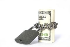 Geld en slot Stock Afbeeldingen