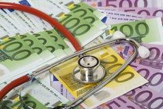 Geld en stethoscoop Royalty-vrije Stock Foto's