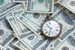 Geld en tijd stock foto's