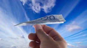Geld en vliegtuigen stock fotografie