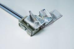 Geld, Euro en slijper Stock Fotografie