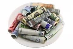 Geld für eine weiße Hochebene lizenzfreie stockfotos