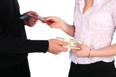 Geld gegen Dokumente Stockfotografie