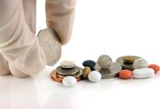 Geld of geneeskunde?? royalty-vrije stock fotografie