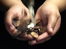 Geld-Hände Stockfoto