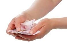 Geld in handen Stock Foto's