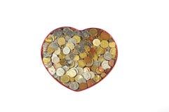 Geld in hart Stock Afbeelding