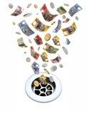 Geld hinunter den Ablaß Lizenzfreie Stockfotografie