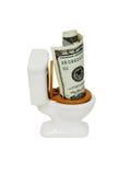 Geld hinunter die Toilette Stockfoto