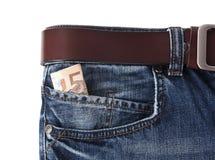 Geld in Ihren Taschenjeans Stockbilder