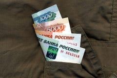 Geld in Ihrer Tasche Stockfotografie