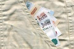 Geld in Ihrer Tasche Stockfotos