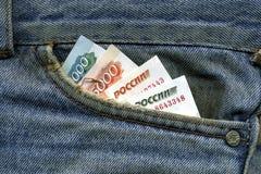 Geld in Ihrer Tasche Stockbild