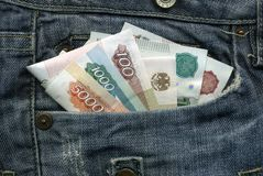 Geld in Ihrer Tasche Lizenzfreie Stockfotos