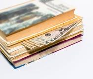 Geld im Buch Stockfotografie