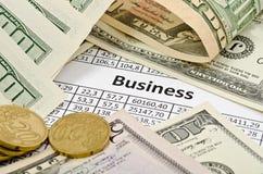 Geld im Geschäft Stockbild