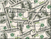 Geld-Investitionspuzzlespiel Stockfotos