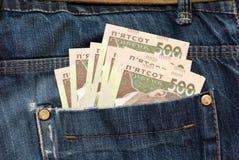 Geld ist in einer Tasche Lizenzfreies Stockfoto