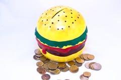 Geld-Kasten in der Form des Burgers Lizenzfreies Stockfoto