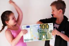 Geld-Kind Stockbild