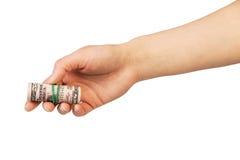 Geld in menselijke hand stock afbeeldingen