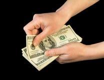 Geld in menselijke handen stock foto