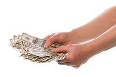 Geld in menselijke handen stock fotografie
